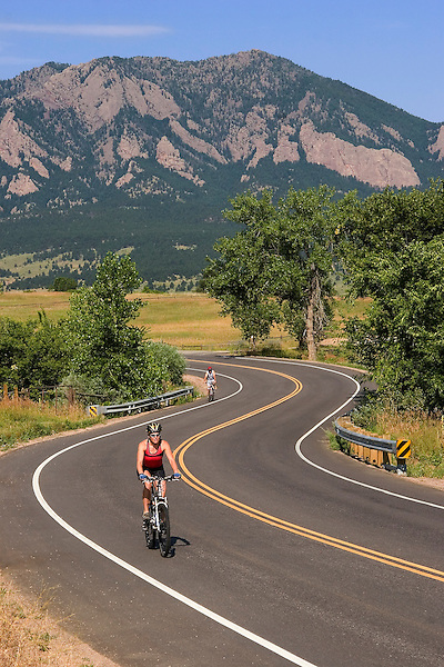 Woman cycling on rural road, Boulder, Colorado John offers private photo tours of Boulder, Denver and Rocky Mountain National Park. .  John leads private photo tours in Boulder and throughout Colorado. Year-round.