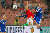 Hungary's Peter Szakaly (C) and Israel's Avihay Yadin (R) jump for a header during a friendly football match Hungary playing against Israel in Budapest, Hungary on August 15, 2012. ATTILA VOLGYI