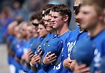 Thomas Kerr and fellow Western Nevada College Wildcats listen to the National Anthem before a college baseball game at John L. Harvey Field in Carson City, Nev., on Friday, April 11, 2014. <br /> Photo by Cathleen Allison/Nevada Photo Source