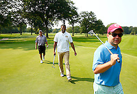 Jalen Rose walks the green with Greg Boll (left) and Bill Pulte (right) during the 5th annual Jalen Rose Leadership Academy golf tournament at the Detroit Golf Club in Detroit, Michigan on Monday August 31, 2015. (Photo by Jared Wickerham/The Players Tribune)