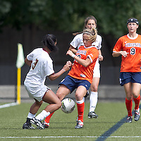 University of Virginia forward Caroline Miller (10) battles for the ball at midfield. Boston College defeated University of Virginia, 2-0, at the Newton Soccer Field, on September 18, 2011.
