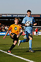 Luke Berry of Cambridge United crosses past Jonathan Smith of York during the Blue Square Bet Premier match between Cambridge United and York City at the Abbey Stadium, Cambridge on 19th March, 2011.© Kevin Coleman 2011