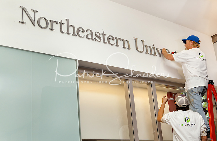 Installation of the signage at the Northeastern University's new Charlotte, North Carolina, Thursday afternoon October 27, 2011...Photography by: Patrick Schneider Photo.com