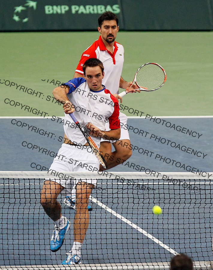 Serbian Davis Cup players Nenad Zimonic (R) and Viktor Troicki (L)  returns the ball, during  dubles match against Michael Llodra and Arnaud Clement of France , Davis Cup finals, Serbia vs France in Belgrade Arena in Belgrade, Serbia, Saturday, 4. December 2010. (credit & photo: Srdjan Stevanovic/Starsportphoto.com©)
