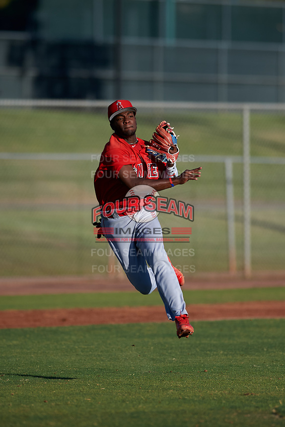AZL Angels third baseman Julio De La Cruz (44) throws to first base during an Arizona League game against the AZL Giants Black at the Giants Baseball Complex on June 21, 2019 in Scottsdale, Arizona. AZL Angels defeated AZL Giants Black 6-3. (Zachary Lucy/Four Seam Images)