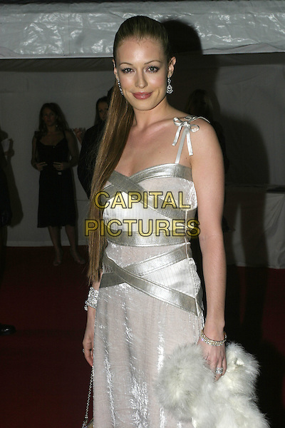 CAT DEELEY.Moet & Chandon Fashion Tribute 2005, .Old Billingsgate Market, London, February 16th 2005..half length white velvet silver dress straps long straight hair extensions ring wedding engagement finger.Ref: AH.www.capitalpictures.com.sales@capitalpictures.com.©Capital Pictures.