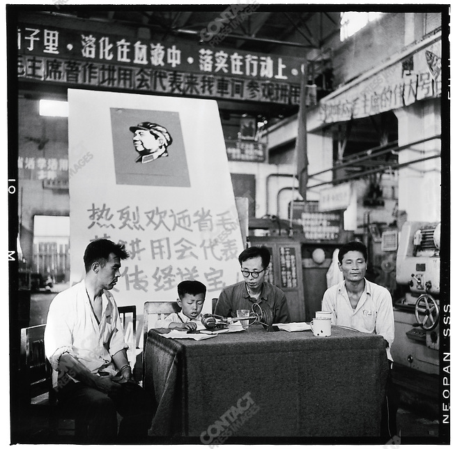 At the Harbin Power Equipment Factory, a young boy is the showpiece of the First Provincial Conference of Learning and Applying Mao Zedong Thought, Heilongjiang province, 28 July 1967 .