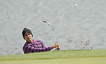 JEJU, SOUTH KOREA - APRIL 23:  Himmat Rai of India chips into the 7th green during the fog-delayed Round One of the Ballantine's Championship at Pinx Golf Club on April 23, 2010 in Jeju island, South Korea. Photo by Victor Fraile / The Power of Sport Images
