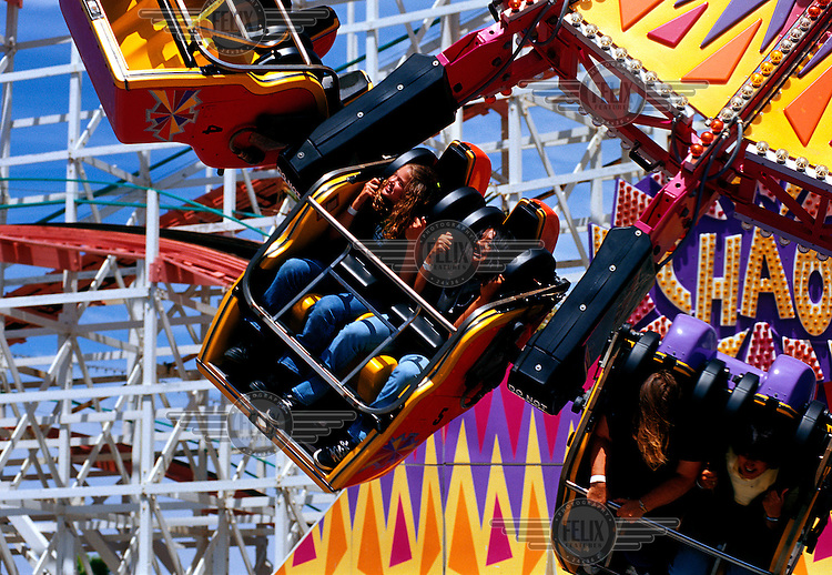 Fairground-goers on a speedy ride in a suburb of northern San Diego.