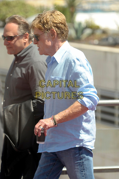 Robert Redford.'All is Lost' photocall at 66th Cannes Film Festival, France..22nd May 2013.half side profile length sunglasses shades blue shirt jeans denim cup drink beverage.CAP/PL.©Phil Loftus/Capital Pictures.