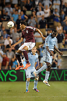 Rapids Andre Akpan (19) wins the aerial battle with Sporting's C.J Sapong..Sporting Kansas City defeated Colorado Rapids 2-0 in Open Cup play at LIVESTRONG Sporting Park, Kansas City, Kansas.