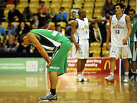 Jets guard Kane Hokianga hangs his head at the final whistle after the 67-90 loss. NBL  - Manawatu Jets  v Wellington Saints at Arena Manawatu, Palmerston North, New Zealand on Friday 17 June 2011. Photo: Dave Lintott / lintottphoto.co.nz