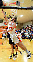 Westside Eagle Observer/MIKE ECKELS<br /> <br /> Brayden Trembly fights his way to the basket for a reverse layup during the Gravette-Pea Ridge conference matchup in the competition gym Friday night. Trembly played his final home game of his high school career.