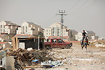 A Palestinian youth riding his horse at the site of a scrap metal merchants opposite the Israeli Settlement of Ma'ale Adumim, in  Al 'Eizariya (Bethany) near Jerusalem on 03/06/2010.