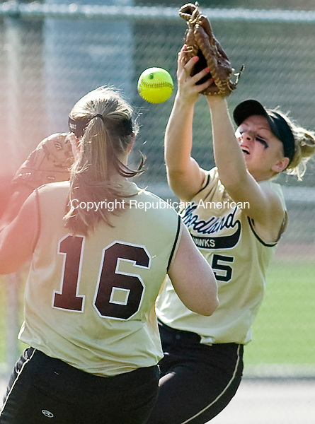 NAUGATUCK--21 April 2008--042108TJ03 - Woodland's Lindsay Boland (5), right, misses a foul ball as Aubrey Roulanaitis (16) comes in to help during Naugatuck High School's 3-2 win against Woodland Regional High School on Monday, April 21, 2008. (T.J. Kirkpatrick/Republican-American)