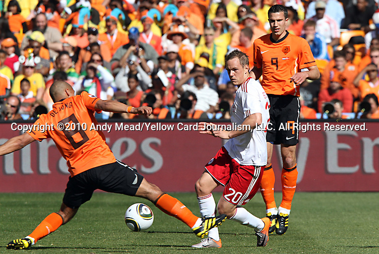 14 JUN 2010:  Nigel de Jong (NED)(8) tries to block a pass by Thomas Enevoldsen (DEN)(20) as Robin van Persie (NED)(9) follows the play.  The Netherlands National Team defeated the Denmark National Team 2-0 at Soccer City Stadium in Johannesburg, South Africa in a 2010 FIFA World Cup Group E match.
