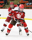 Danny Biega (Harvard - 9), Jacob Drewiske (St. Lawrence - 13) - The Harvard University Crimson defeated the St. Lawrence University Saints 4-3 on senior night Saturday, February 26, 2011, at Bright Hockey Center in Cambridge, Massachusetts.