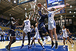 DURHAM, NC - FEBRUARY 04: Duke's Erin Mathias (35) blocks a shot by Notre Dame's Arike Ogunbowale (24). The Duke University Blue Devils hosted the University of Notre Dame Fighting Irish on February 4, 2018 at Cameron Indoor Stadium in Durham, NC in a Division I women's college basketball game. Notre Dame won the game 72-54.