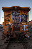A graffiti laden old caboose in Vernon, a very industrial city in the shadow of downtown Los Angeles, California, USA