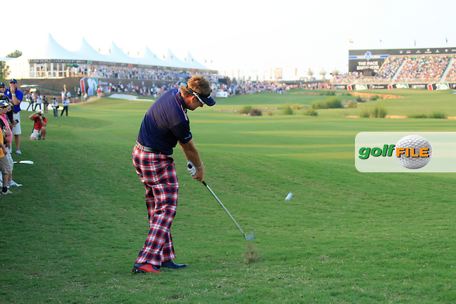 Ian Poulter takes his 2nd shot from the rough on the 18th hole during Day 3 of the Dubai World Championship, Earth Course, Jumeirah Golf Estates, Dubai, 27th November 2010..(Picture Eoin Clarke/www.golffile.ie)