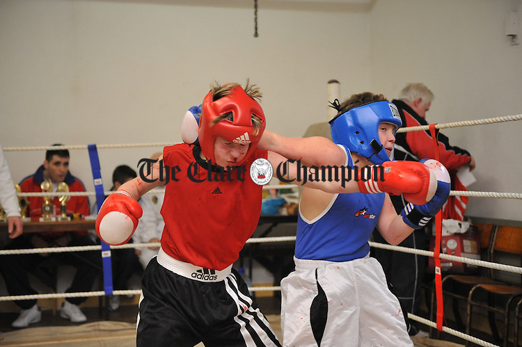 Luke Carmody of Ennis Boxing Club  in action against Brian Mc Ginley of Galway Olympic during the Ennis V Olympic tournament in Chapel Lane. Photograph by John Kelly.