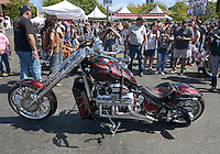 NWA Democrat-Gazette/BEN GOFF @NWABENGOFF<br /> The custom motorcycle belonging to Rod Guinn of Muskogee, Okla. sits on display on Saturday Sept. 26, 2015 after competing in the Stokes Air Battle of the Bikes at the annual Bikes, Blues & BBQ motorcycle rally in downtown Fayetteville. Guinn won the chopper category with the 500 horsepower bike built by V8 Choppers in Miami, Okla.