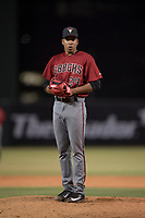 AZL Diamondbacks relief pitcher Raibel Custodio (24) looks to his catcher for the sign during an Arizona League game against the AZL Angels at Tempe Diablo Stadium on June 27, 2018 in Tempe, Arizona. The AZL Angels defeated the AZL Diamondbacks 5-3. (Zachary Lucy/Four Seam Images)