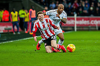 Matt Targett of Southampton  is fouled by Andre Au of Swansea during the Barclays Premier League match between Swansea City and Southampton  played at the Liberty Stadium, Swansea  on February 13th 2016
