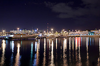 Reflection of lights from boats in the Honolulu Harbor at night, O'ahu