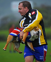 Bulldogs mascot Jackson is carted off after a pitch invasion during the Wellington Australian Rules Football club final match between the Bulldogs and North City Demons at Hutt Park, Wellington, New Zealand on Saturday, 22 November 2014. Photo: Dave Lintott / lintottphoto.co.nz