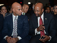 Washington, DC - January 2, 2015: Former D.C. mayor Adrian Fenty and Philadelphia Mayor Michael Nutter chat during the 2015 inauguration ceremony held at the Washington Convention Center, January 2, 2015.   (Photo by Don Baxter/Media Images International)
