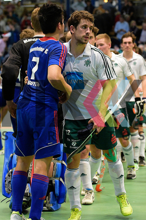 GER - Luebeck, Germany, February 06: After the 1. Bundesliga Herren indoor hockey semi final match at the Final 4 between Uhlenhorst Muelheim (white) and Mannheimer HC (blue) on February 6, 2016 at Hansehalle Luebeck in Luebeck, Germany.  Final score 2-3 (HT 7-5).  Tino Nguyen Luong #7 of Mannheimer HC, Benedikt Fuerk #12 of HTC Uhlenhorst Muehlheim<br /> <br /> Foto &copy; PIX-Sportfotos *** Foto ist honorarpflichtig! *** Auf Anfrage in hoeherer Qualitaet/Aufloesung. Belegexemplar erbeten. Veroeffentlichung ausschliesslich fuer journalistisch-publizistische Zwecke. For editorial use only.