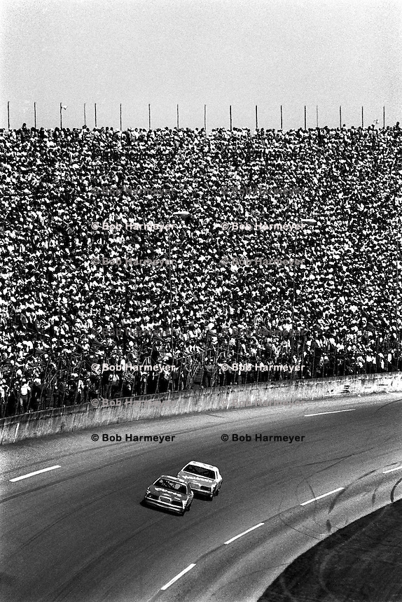 DAYTONA BEACH, FL - FEBRUARY 17: Daytona 500 winner Bill Elliott drives the Harry Melling Ford Thunderbird ahead of Cale Yarborough in the Harry Ranier Ford Thunderbird during the Daytona 500 NASCAR Winston Cup race at the Daytona International Speedway in Daytona Beach, Florida on February 17, 1985.