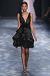 Model Alecia walks runway in a black satin-faced organza cocktail with plunging neckline and laser-cut black organza flowers, from the Marchesa Fall 2016 collection by Georgina Chapman and Keren Craig, presented at NYFW: The Shows Fall 2016, during New York Fashion Week Fall 2016.