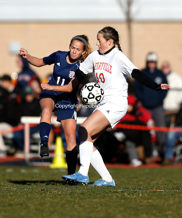 Terryville, CT- 11 November 2016-111116CM12- Terryville's Caylee Brown right, attempts to stop the ball kicked by Bolton's Christina Langton during their state tournament matchup on Friday.     Christopher Massa Republican-American