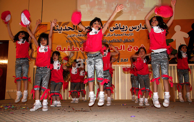 Palestinian children participate in the graduation ceremony at their kindergarten in the West Bank city of Nablus on June 12,2011. Photo by Wagdi Eshtayah