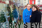 Claire Naughton and Helena O'Carroll admiring the christmas window at McKennas of Listowel.