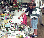 Washington, DC - September 6, 1997 -- Patricia Nance, who recently moved to the Washington, DC area, points out some of the tributes to the late Princess Diana to her son James, aged 8, waiting for the British Embassy in Washington, DC to open to sign the Book of Condolence for Princess Diana on September 6, 1997.  The Princess was killed in a car crash in Paris, France.<br /> Credit: Ron Sachs / CNP