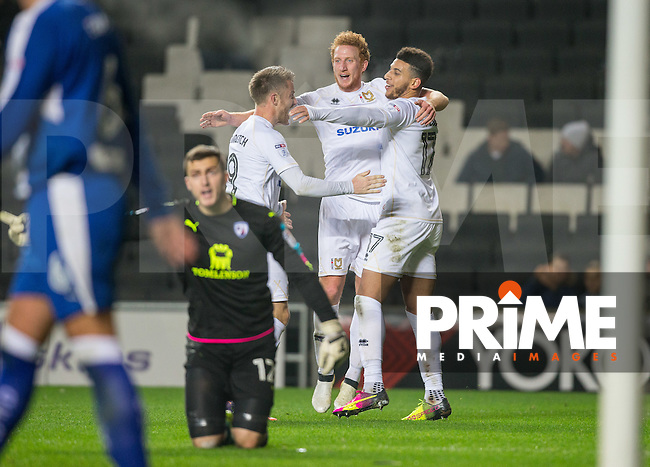 Daniel Powell (17) of Milton Keynes Dons celebrates his goal with teammates during the Sky Bet League 1 match between MK Dons and Chesterfield at stadium:mk, Milton Keynes, England on 22 November 2016. Photo by Andy Rowland.