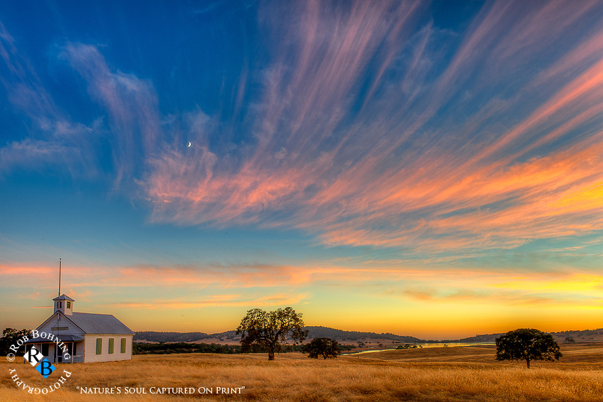 A magical sunset over an old schoolhouse in the Sierra foothills