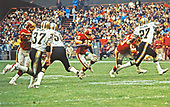 Washington Redskins running back Benny Malone (25) carries the ball against the New Orleans Saints at Robert F. Kennedy Stadium in Washington, DC on October 28, 1979.  Defending on the play are Saints free safety Tom Myers (37), left linebacker Ken Bordelon (50), and strong safety Ray Brown (27).  The blockers for Malone include offensive tackle Fred Dean (63). The Saints won the game 14 - 10.<br /> Credit: Arnie Sachs / CNP