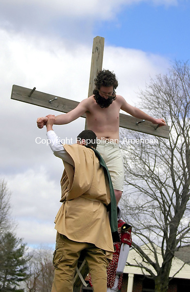 SOUTHBURY, CT -06 APRIL 2007 - -040607DA03--Benjamin Carr portrays Jesus as he is carried down off the cross after the crucifixion by Peter Foschi portraying Joseph of Arimathaea  during The Good Walk Friday that was held in Southbury Friday morning ending at Sacred Heart Church.<br />  Darlene Douty/Republican-American
