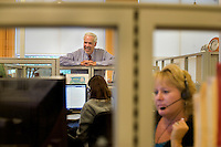A portrait of Paul LeBlanc, president of Southern New Hampshire University, in the call center of the school's College of Online and Continuing Education (COCE) at the Riverwalk Mills Building in downtown Manchester, New Hampshire.  The call center is the first point of contact for prospective students at the university who indicate interest in the school through the website. The COCE offices are separate from the main campus of SNHU, occupying approximately 33,000 square feet and two floors of one of the city's old industrial buildings. The COCE opened at that location about 5 years ago, and currently has plans to increase its size by another 36,000 square feet. The COCE offices are filled with admissions, advising, and other administrative personnel, currently about 150, that provide the infrastructure for students enrolled in SNHU classes worldwide...Photo by M. Scott Brauer for the Chronicle of Higher Education
