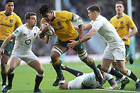 Lopeti Timani of Australia looks for a gap between George Ford and Owen Farrell of England during the Old Mutual Wealth Series match between England and Australia at Twickenham Stadium on Saturday 3rd December 2016 (Photo by Rob Munro)