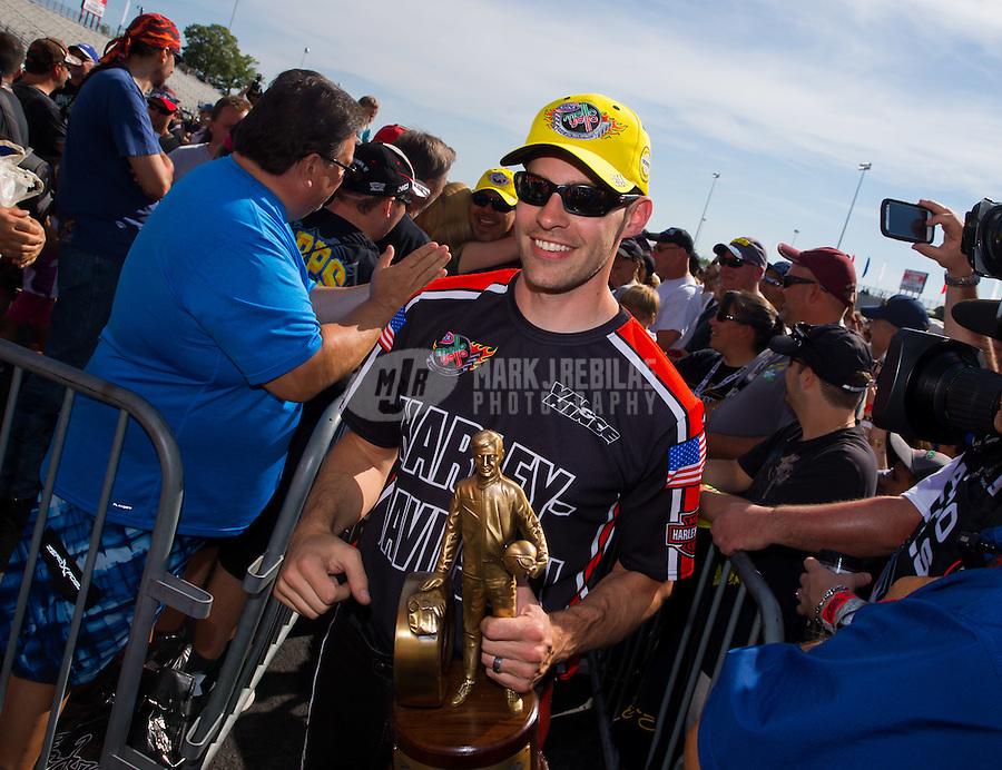 Jun. 1, 2014; Englishtown, NJ, USA; NHRA pro stock motorcycle rider Andrew Hines celebrates after winning the Summernationals at Raceway Park. Mandatory Credit: Mark J. Rebilas-