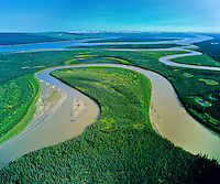 Velvia 120 50 ISO.  Pentax 45mm lens. F5.6 at 1/1000.           Confluence of Carcajou River and Mackenzie River. Caracajou wetlands in foreground.    Mackenzie Valley,  NWT, August 2005               This region will be directly impacted by the proposed Mackenzie Valley National Gas Pipeline. This pipeline would bring gas from the Beaufort Sea. The primary destination for the natural gas will be to fuel the energy needs of the Alberta Oil Sands mega-project.  Copyright Garth Lenz. Contact: lenz@islandnet.com www.garthlenz.com