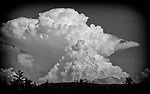 Menacing thunderhead developing.  B&W scene is taken from the profile showing a dramatic cloud.