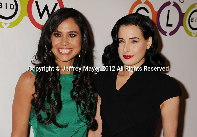 WEST HOLLYWOOD, CA - NOVEMBER 14: Kimberly Snyder and Dita Von Teese attend the opening of Kimberly Snyder's Glow Bio Juice Bar at Glow Bio on November 14, 2012 in West Hollywood, California.