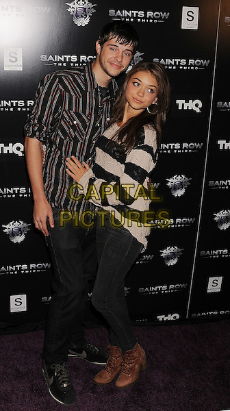 Matt Prokop, Sarah Hyland.Saints Row: The Third concert and event Held at Superclub, Hollywood, California, USA..October 12th, 2011.full length coupe side jeans denim black stripe beige sweater jumper top shirt.CAP/ROT/TM.©Tony Michaels/Roth Stock/Capital Pictures