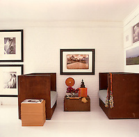 The steel table and sofas were custom made in Mexico and are grouped with a photograph by Robert Curran and images of Lisa Fonssagrives by Horst